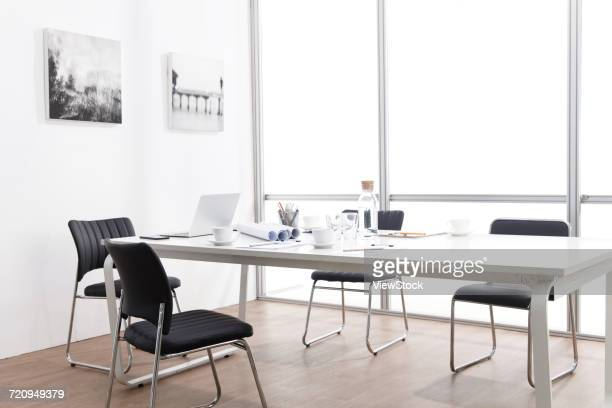 view of conference room table and chairs - floorboard stock photos and pictures