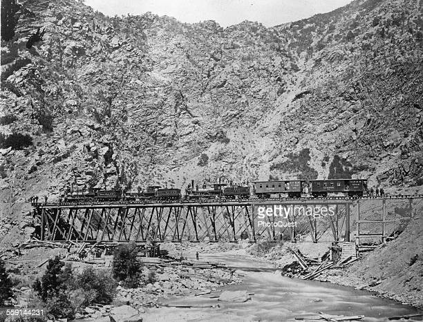 View of construction of the Union Pacific section of the Transcontinental Railroad across Devil's Gate Bridge Utah 1869