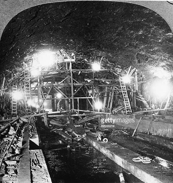 View of construction scaffolding inside a newly excavated subway tunnel New York City circa 1900