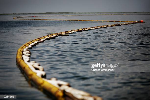 A view of containment booms that hold back the oil spill on May 27 2010 in Barataria Bay Louisiana The area is home to thousands of brown pelicans...