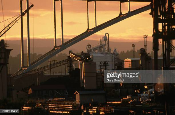 View of conveyors elevators and industrial buildings under the Fremont Bridge at sunset Portland Oregon