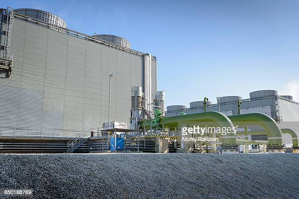 view of cooling towers at gas-fired power station - cooling tower stock pictures, royalty-free photos & images