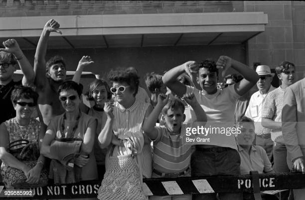 View of counterdemonstrators behind a police fence on the Atlantic City Boardwalk during a Miss America beauty pageant protest Atlantic City New...