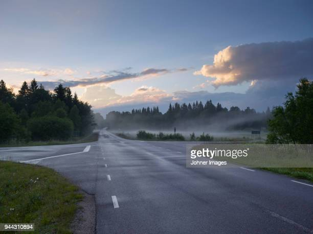 view of country road - crossroad stock pictures, royalty-free photos & images