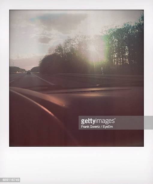 view of country road through window - frank swertz stock pictures, royalty-free photos & images