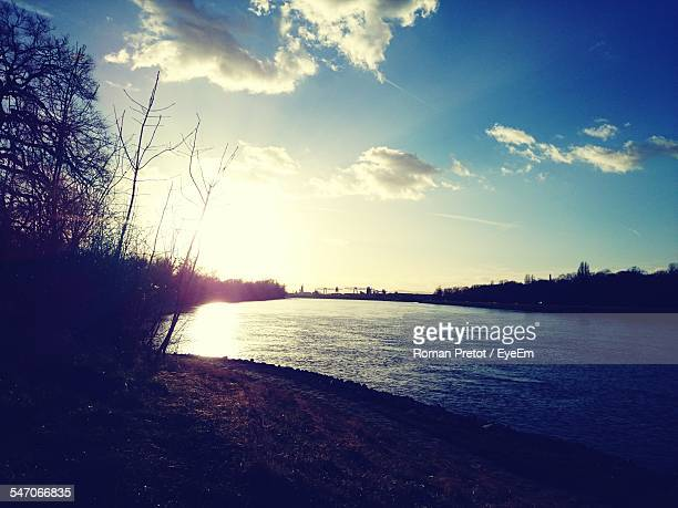 view of countryside lake against sky - roman pretot stock-fotos und bilder