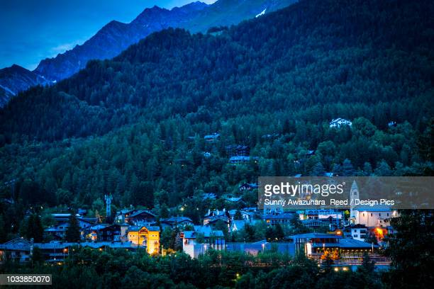 View of Courmayeur city center and mountains at dusk