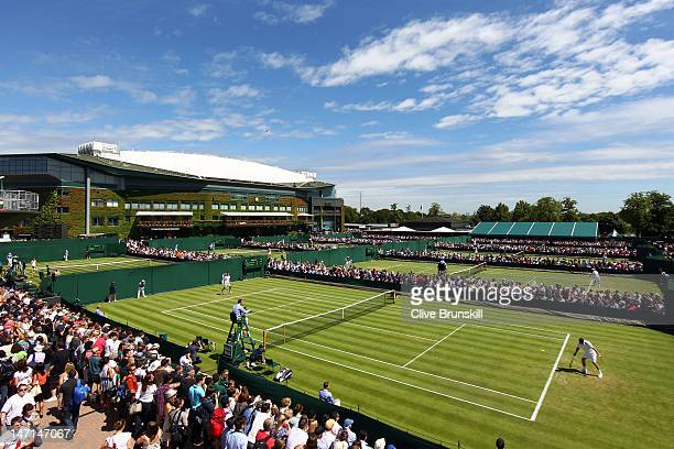 A view of courts 8 and 9 with Centre Court in the background on day two of the Wimbledon Lawn Tennis Championships at the All England Lawn Tennis and...