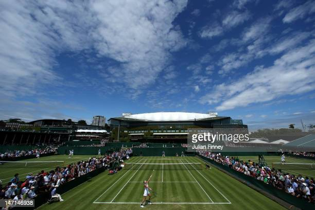 A view of courts 9 10 and 11 with Centre Court in the background on day two of the Wimbledon Lawn Tennis Championships at the All England Lawn Tennis...