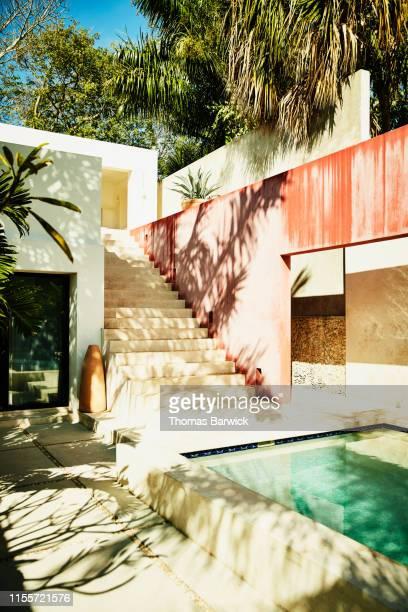 view of courtyard and pool in tropical villa - tropical tree stockfoto's en -beelden