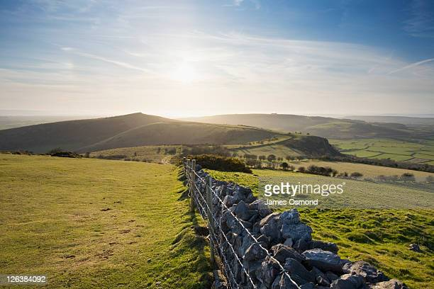 view of crook peak from wavering down in the mendip hills in spring. somerset, england. uk. - hill stock pictures, royalty-free photos & images