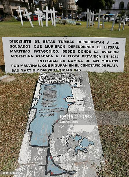 View of crosses a sign and a map with the names of the soldiers who stayed at the continental platform during the 1982 Malvinas Islands War placed by...