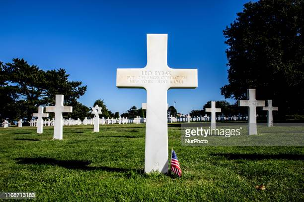View of crosses at Normandy American Cemetery on September 15, 2019 near Colleville-Sur-Mer, France. Normandy American Cemetery contains the graves...