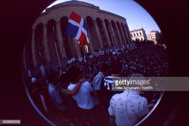 view of crowd through lens - dominican republic flag stock pictures, royalty-free photos & images