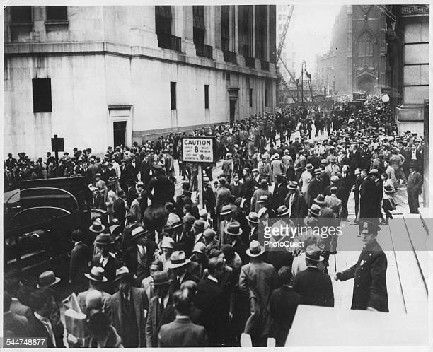 View of crowds of people on Wall Street during the stock market crash, known as Black Tuesday, New York, New York, October 29, 1929.