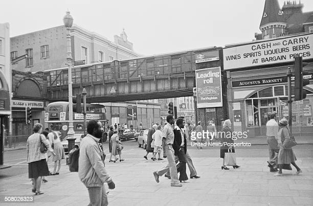 View of crowds of people shopping on the streets of Brixton town centre in South London on 9th September 1981