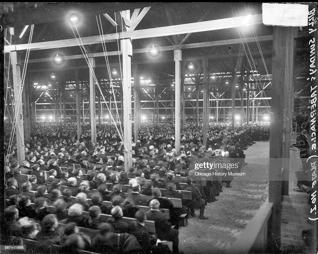 Outstanding View Of Crowds Of People Sitting On Benches In Rows Inside Alphanode Cool Chair Designs And Ideas Alphanodeonline