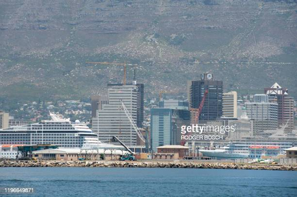 A view of cruise ships docked in the Cape Town Harbour with the city and Table Mountain in the background on January 16 in Cape Town
