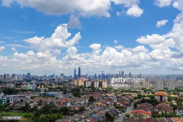 view of cumulus clouds over down town kuala lumpur, malaysia. - shaifulzamri foto e immagini stock