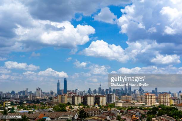 view of cumulus clouds over down town kuala lumpur, malaysia - shaifulzamri stock pictures, royalty-free photos & images