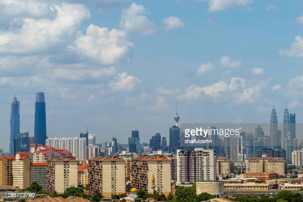 view of cumulus clouds over down town kuala lumpur, malaysia. - shaifulzamri stock pictures, royalty-free photos & images