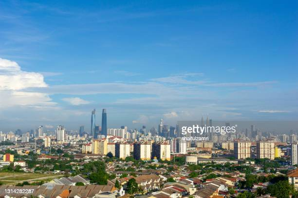 view of cumulus clouds over down town kuala lumpur, malaysia. - shaifulzamri imagens e fotografias de stock