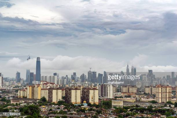 view of cumulus clouds over down town kuala lumpur - shaifulzamri stock pictures, royalty-free photos & images