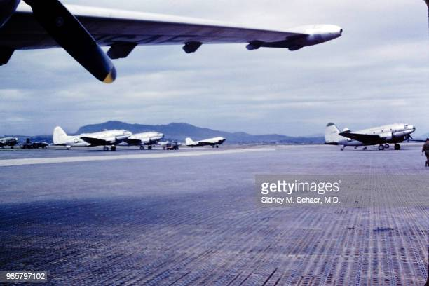 View of Curtiss C46 Commando transport planes as they sit at Kimpo Air Base Seoul South Korea July 1952