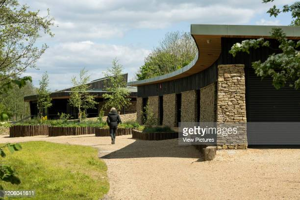 View of curved roof line of pavilion with main pavilion in background. Lakeside Centre, Eastleigh, United Kingdom. Architect: R H Partnership...