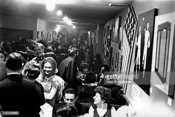 View of customers as they crowd inside Max's Kansas City New York New York December 19 1966 The artwork on the wall was provided by various artists...