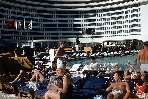 A view of customers at the pool in the Fontainebleau hotel on the beach in Miami Beach Florida
