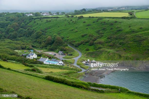 view of cwm yr eglwys beach from high up - newport wales stock pictures, royalty-free photos & images