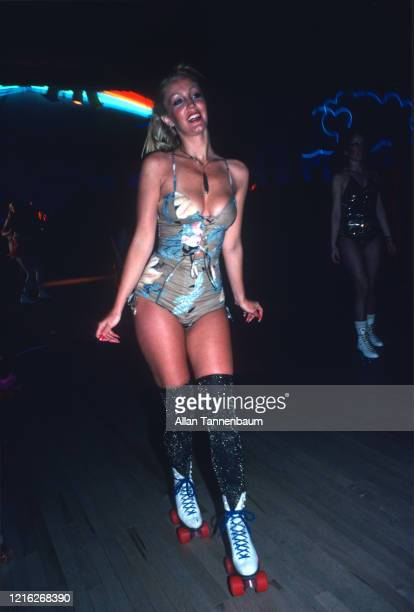 View of Cynthia Rixon in a lowcut onepiece outfit as she rollerskates at the Roxy Roller Disco during a party for the US Olympic Men's Ice Hockey...