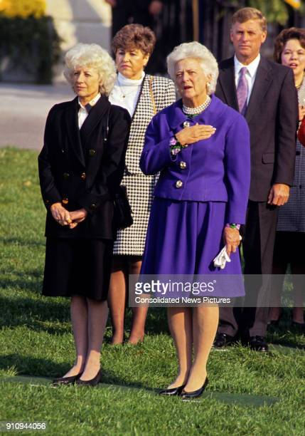 View of Czech First Lady Olga Havlova and US First Lady Barbara Bush as they attend a State Arrival ceremony from the Havels on White House's South...