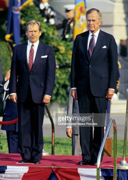 View of Czech President Vaclav Havel and US President George HW Bush on a reviewing stand on the White House's South Lawn during the former's State...