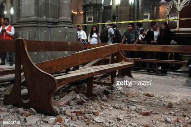 View of damage caused inside a church by an earthquake in Quetzaltenango 220 km from Guatemala City on June 14 2017 A strong 69 magnitude earthquake...