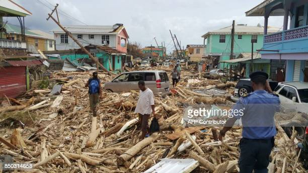 TOPSHOT View of damage caused the day before by Hurricane Maria in Roseau Dominica on September 20 2017 Hurricane Maria smashed into the eastern...