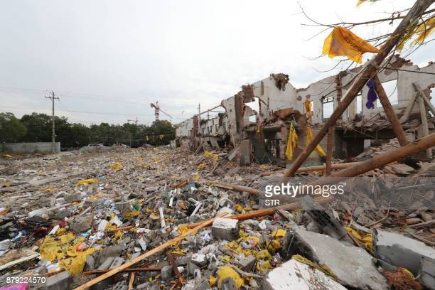 A view of damaged buildings at the site of an explosion in Ningbo China's eastern Zhejiang province on November 26 2017 A major explosion hit China's...
