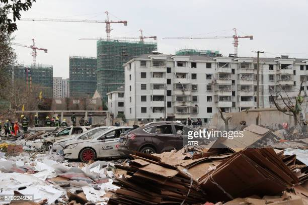 A view of damaged cars and buildings at the site of an explosion in Ningbo China's eastern Zhejiang province on November 26 2017 A major explosion...
