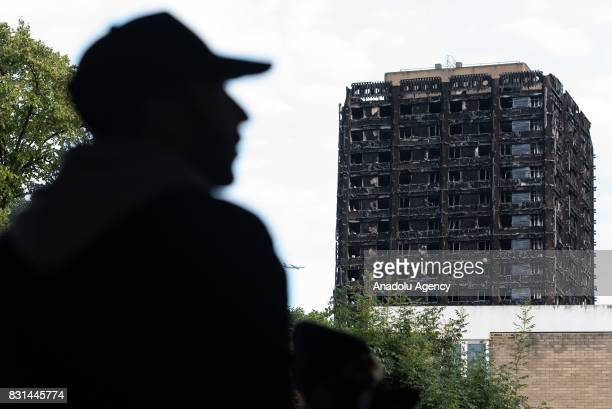 A view of damaged Grenfell Tower in the aftermath of fire accident during a silent peaceful march two months on from the disaster in London England...