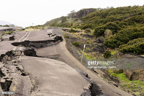 view of damaged road - vernieling stockfoto's en -beelden