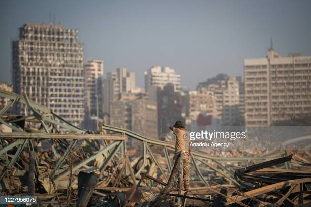 View of damaged site is seen as search and rescue operations continue after a fire at a warehouse with explosives at the Port of Beirut led to...
