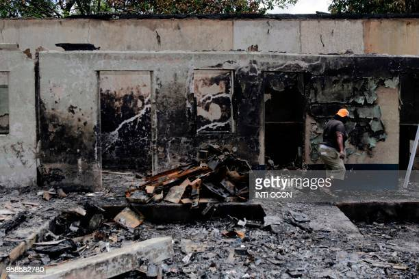 View of damages at the Town Hall, set on fire during recent protests, in Masaya, some 40 km from Managua, Nicaragua, on May 14, 2018. - Nicaragua's...