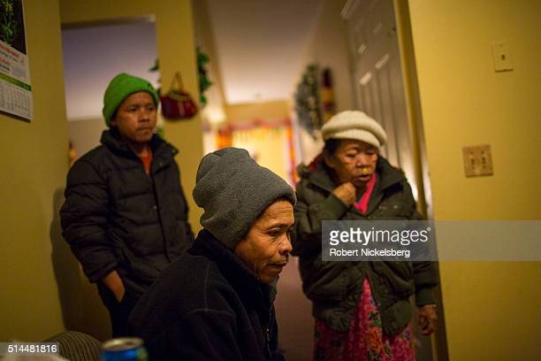 View of Dambar Gurung in his younger brother Dil's apartment Burlington Vermont December 8 2015 Behind him is Dil and their mother Man Maya Gurung...