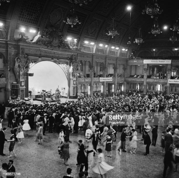 View of dancers and audience members on the dancefloor being entertained by a jazz band on stage at the Winter Gardens venue in Blackpool Lancashire...