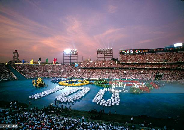 View of dancers and performers participating in the opening ceremony of the 1996 Olympic Games inside the Centennial Olympic Stadium in Atlanta...