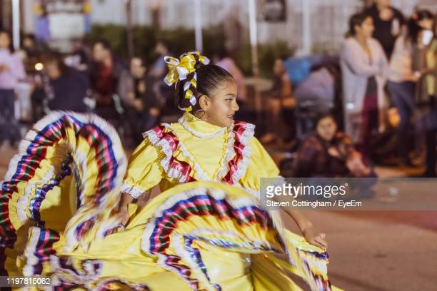 view of dancing girl in traditional clothing - steven cottingham stock-fotos und bilder
