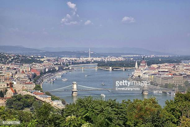 view of danube river and city center - emreturanphoto stock pictures, royalty-free photos & images