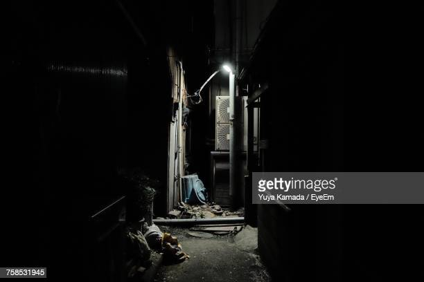 view of dark alley - alley stock pictures, royalty-free photos & images