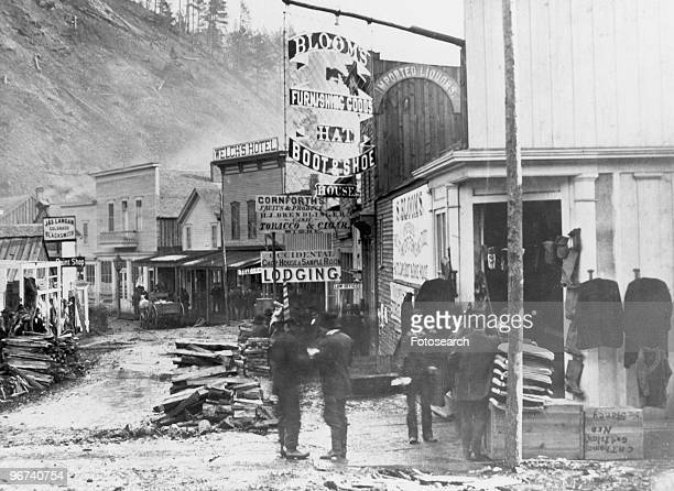 View of Deadwood in South Dakota in its heyday as photographed by FJ Haynes showing store fronts and a group of men in Deadwood South Dakota USA...